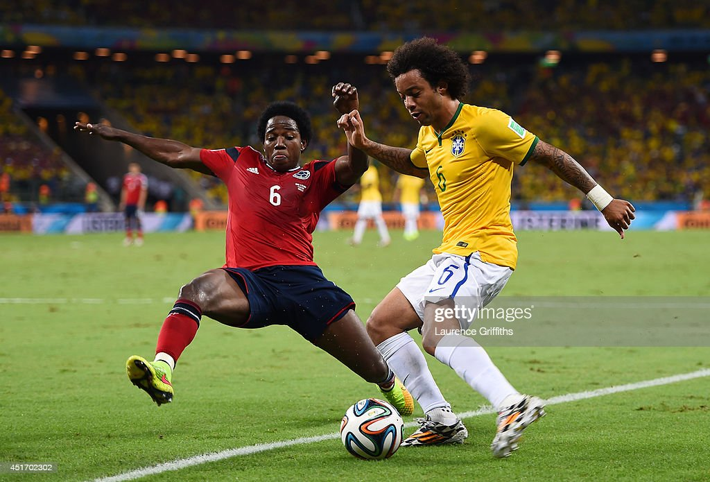 Carlos Sanchez of Colombia challenges Marcelo of Brazil during the 2014 FIFA World Cup Brazil Quarter Final match between Brazil and Colombia at...