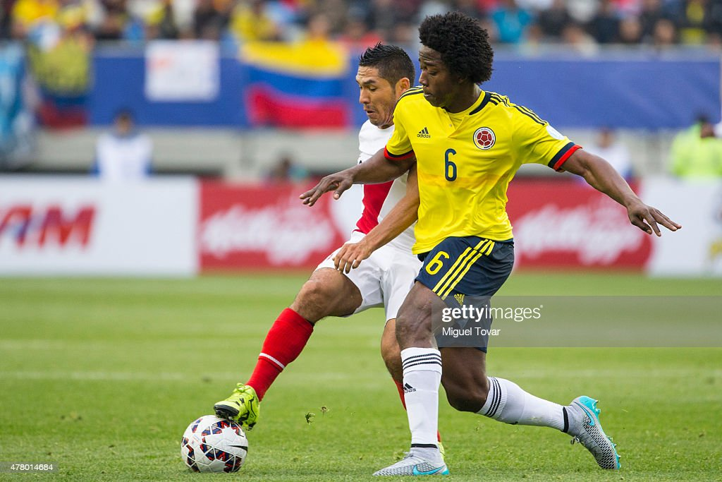 Carlos Sanchez of Colombia fights for the ball with Joel Sanchez of Peru during the 2015 Copa America Chile Group C match between Colombia and Peru at Municipal Bicentenario Germán Becker Stadium on June 21, 2015 in Temuco, Chile.