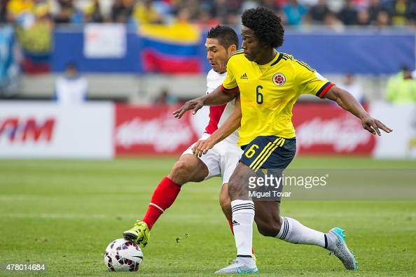 Carlos Sanchez of Colombia fights for the ball with Joel Sanchez of Peru during the 2015 Copa America Chile Group C match between Colombia and Peru...