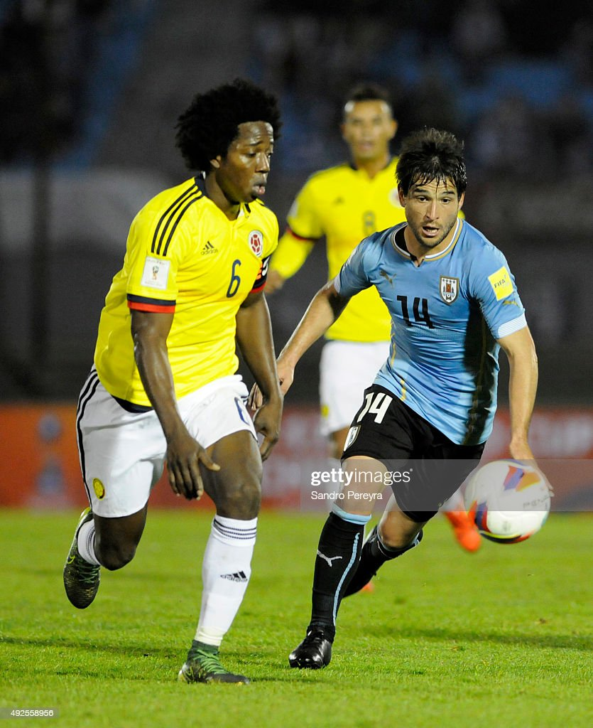 Carlos Sanchez of Colombia (L) fights for the ball with Nicolas Lodeiro of Uruguay (R) during a match between Uruguay and Colombia as part of FIFA 2018 World Cup Qualifier at Centenario Stadium on October 13, 2015 in Montevideo, Uruguay.