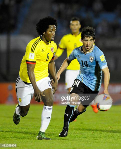 Carlos Sanchez of Colombia fights for the ball with Nicolas Lodeiro of Uruguay during a match between Uruguay and Colombia as part of FIFA 2018 World...