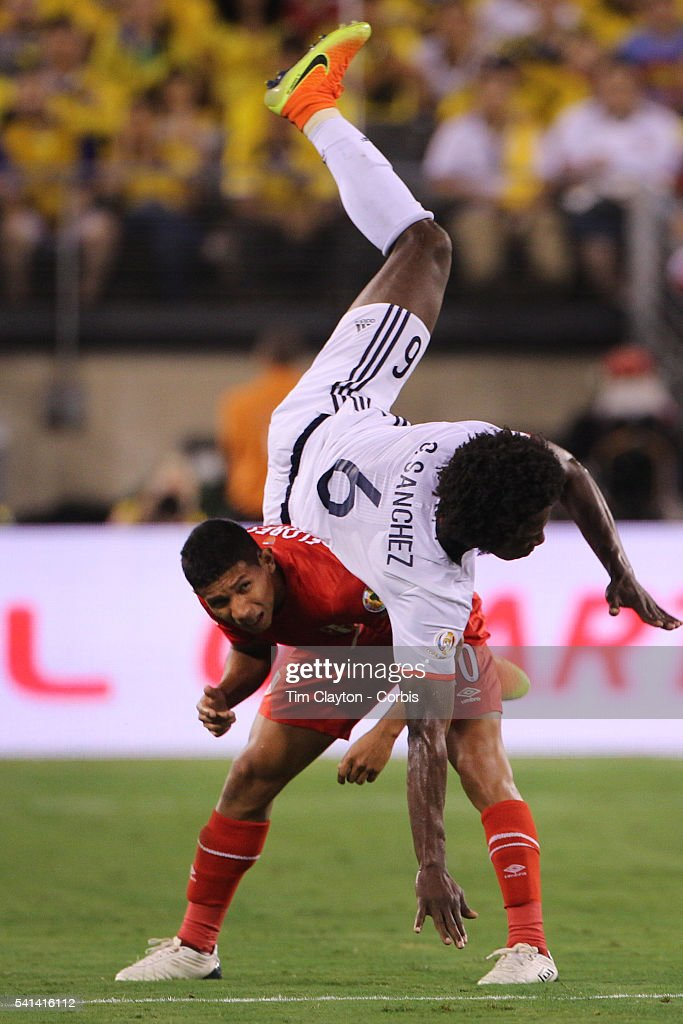 Carlos Sanchez #6 of Colombia goes head over heals over <a gi-track='captionPersonalityLinkClicked' href=/galleries/search?phrase=Edison+Flores&family=editorial&specificpeople=8597891 ng-click='$event.stopPropagation()'>Edison Flores</a> #20 of Peru during the Colombia Vs Peru Quarterfinal match of the Copa America Centenario USA 2016 Tournament at MetLife Stadium on June 17, 2016 in East Rutherford, New Jersey.
