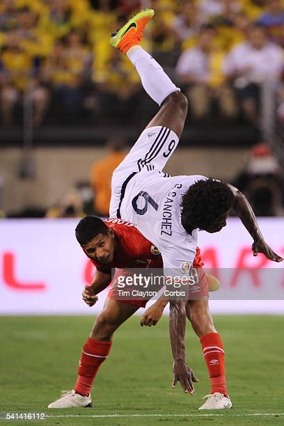 Carlos Sanchez of Colombia goes head over heals over Edison Flores of Peru during the Colombia Vs Peru Quarterfinal match of the Copa America...