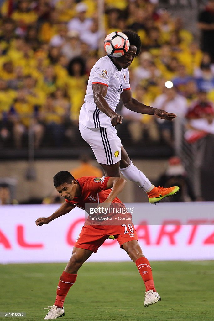 Carlos Sanchez #6 of Colombia heads clear from <a gi-track='captionPersonalityLinkClicked' href=/galleries/search?phrase=Edison+Flores&family=editorial&specificpeople=8597891 ng-click='$event.stopPropagation()'>Edison Flores</a> #20 of Peru during the Colombia Vs Peru Quarterfinal match of the Copa America Centenario USA 2016 Tournament at MetLife Stadium on June 17, 2016 in East Rutherford, New Jersey.