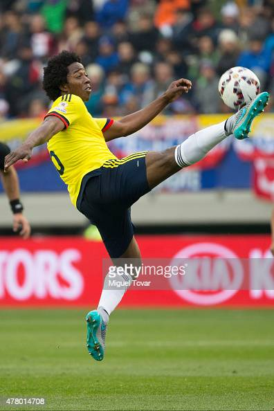 Carlos Sanchez of Colombia jumps to control the ball during the 2015 Copa America Chile Group C match between Colombia and Peru at Municipal...