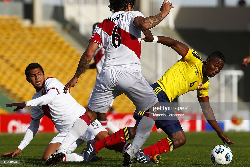 Carlos Sanchez of Colombia struggles for the ball with Juan Vargas of Peru during a quarter final match between Colombia and Peru as part of Copa...