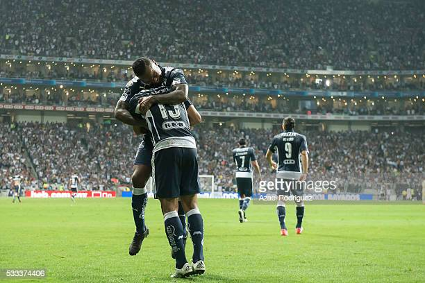 Carlos Sanchez of Monterrey celebrates with teammates after scoring his team's third goal during the semi finals second leg match between Monterrey...