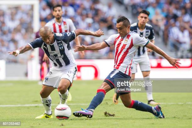 Carlos Sanchez of Monterrey fights for the ball with Edwin Hernandez of Chivas during the 4th round match between Monterrey and Chivas as part of the...