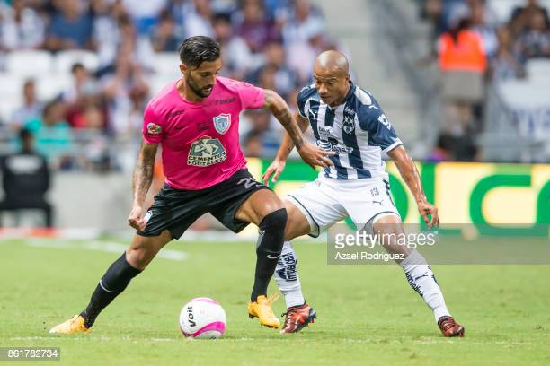 Carlos Sanchez of Monterrey fights for the ball with Robert Herrera of Pachuca during the 13th round match between Monterrey and Pachuca as part of...