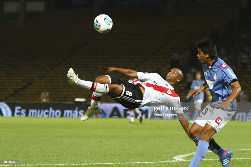 Carlos Sanchez (L) of River fights for the ball with Marquez Fernando (R) of Belgrano during the match between Belgrano and River for the Torneo Final 2013 on February 10, 2013 in Cordoba, Argentina.