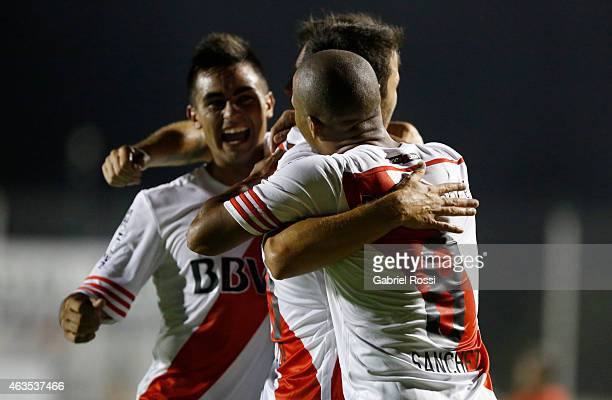 Carlos Sanchez of River Plate and teammates celebrate their team's first goal during a match between Sarmiento and River Plate as part of first round...