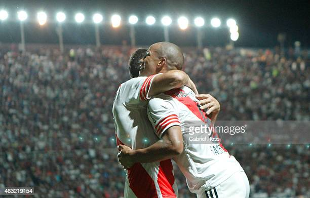 Carlos Sanchez of River Plate celebrates with his teammate after scoring the first goal of his team during a second leg match between San Lorenzo and...