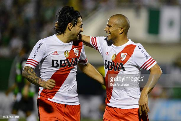 Carlos Sanchez of River Plate celebrates with his teammate Leonardo Pisculichi after scoring the first goal of his team during a match between...