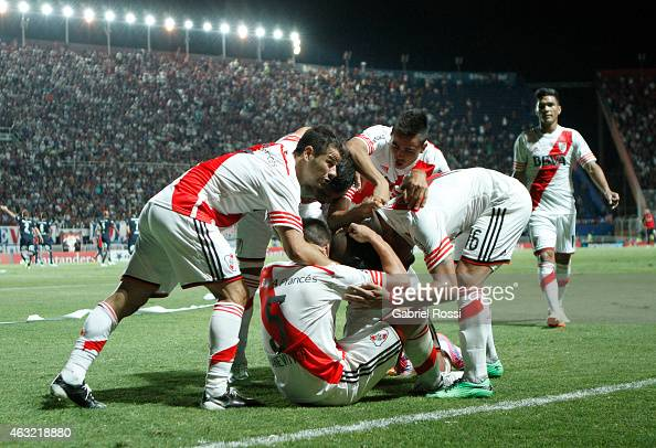 Carlos Sanchez of River Plate celebrates with his teammates after scoring the first goal of his team during a second leg match between San Lorenzo...