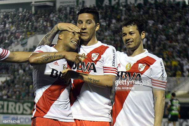 Carlos Sanchez of River Plate celebrates with his teammates after scoring the first goal of his team during a match between Chapecoense and River...