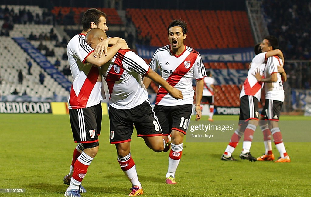 Carlos Sanchez of River Plate celebrates with teammates after scoring during a match between Godoy Cruz and River Plate as part of third round of...