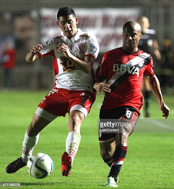 Carlos Sanchez of River Plate fights for the ball with Cristian Espinoza of Huracan during the final match between River Plate and Huracan as part of...