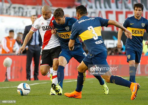 Carlos Sanchez of River Plate fights for the ball with Rodrigo Bentancur of Boca Juniors during a match between River Plate and Boca Juniors as part...