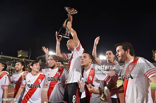 Carlos Sanchez of River Plate lifts the trophy after winning a match between Gamba Osaka and River Plate at Osaka Expo '70 Stadium on August 11 2015...