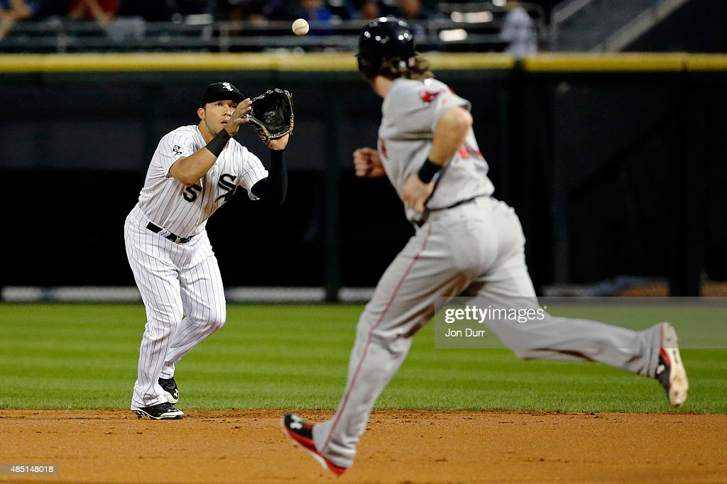 Carlos Sanchez #5 of the Chicago White Sox makes a catch for an out against the Boston Red Sox during the second inning at U.S. Cellular Field on August 24, 2015 in Chicago, Illinois.