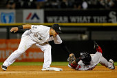 Carlos Sanchez of the Chicago White Sox tags out Rusney Castillo of the Boston Red Sox on an attempt to steal second base during the fourth inning at...