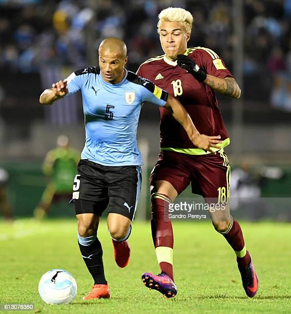 Carlos Sanchez of Uruguay fights for the ball with Adalberto Penaranda of Venezuela during a match between Uruguay and Venezuela as part of FIFA 2018...