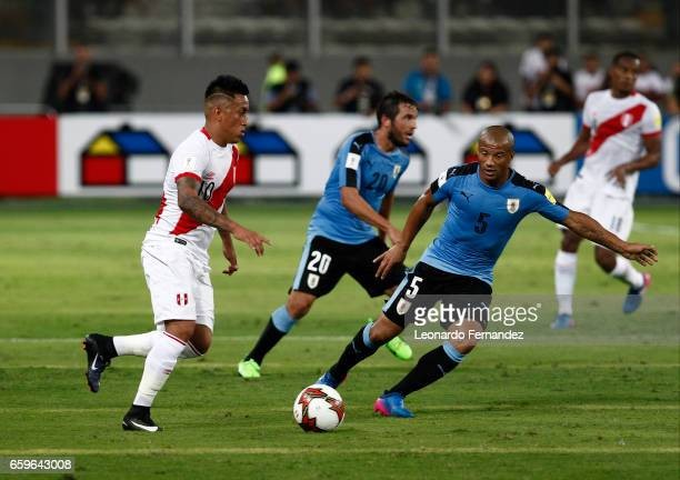 Carlos Sanchez of Uruguay fights for the ball with Christian Cueva of Peru during a match between Peru and Uruguay as part of FIFA 2018 World Cup at...