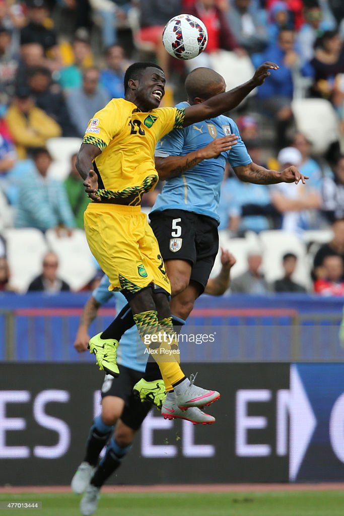 Carlos Sanchez of Uruguay goes for a header with <a gi-track='captionPersonalityLinkClicked' href=/galleries/search?phrase=Kemar+Lawrence&family=editorial&specificpeople=12880296 ng-click='$event.stopPropagation()'>Kemar Lawrence</a> of Jamaica during the 2015 Copa America Chile Group B match between Uruguay and Jamaica at Regional Calvo y Bascuñan Stadium on June 13, 2015 in Antofagasta, Chile.