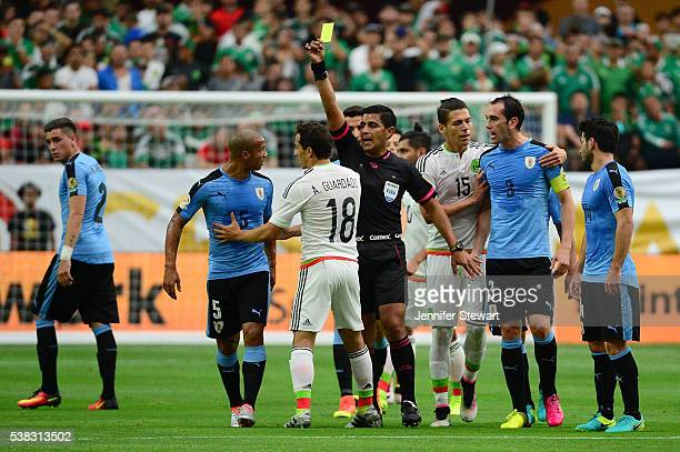 Carlos Sanchez of Uruguay reacts as referee Enriquee Caceres gives Andres Guardado a yellow card in the first half of the 2016 Copa America...