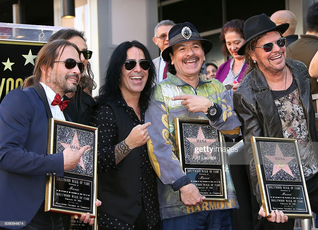<a gi-track='captionPersonalityLinkClicked' href=/galleries/search?phrase=Carlos+Santana+-+Musician&family=editorial&specificpeople=11497837 ng-click='$event.stopPropagation()'>Carlos Santana</a>, Alex Gonzalez, <a gi-track='captionPersonalityLinkClicked' href=/galleries/search?phrase=Sergio+Vallin&family=editorial&specificpeople=2331077 ng-click='$event.stopPropagation()'>Sergio Vallin</a>, <a gi-track='captionPersonalityLinkClicked' href=/galleries/search?phrase=Juan+Calleros&family=editorial&specificpeople=2331076 ng-click='$event.stopPropagation()'>Juan Calleros</a> and <a gi-track='captionPersonalityLinkClicked' href=/galleries/search?phrase=Fher+Olvera&family=editorial&specificpeople=2331075 ng-click='$event.stopPropagation()'>Fher Olvera</a> attend a ceremony honoring the rock band 'Mana' with a star on the Hollywood Walk of Fame on February 10, 2016 in Hollywood, California.
