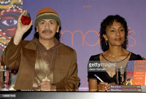 Carlos Santana and Deborah Santana during Carlos and Deborah Santana InStore Appearance For Carlos's New Fragrance 'Carlos Santana' June 5 2006 at...