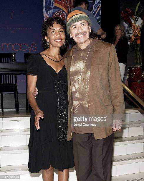 Carlos Santana and Deborah Santana during Carlos Santana and Deborah Santana make an appearence at MACY'S Herald Square to promote his new men's...