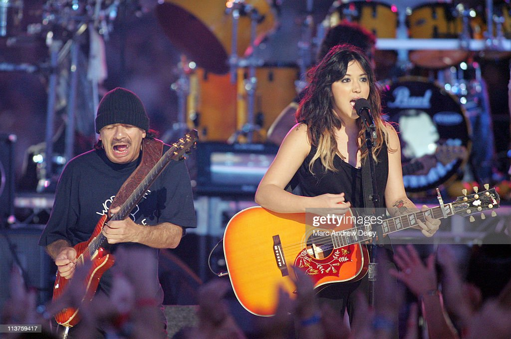 Carlos Santana and Michelle Branch during 2005 NFL Kickoff Foxboro Concert at Gillette Stadium in Foxboro Massachusetts United States
