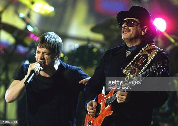 Carlos Santana and Rob Thomas perform during the 42d Annual Grammy Awards in Los Angeles 23 February 2000 Santana received eight awards including...