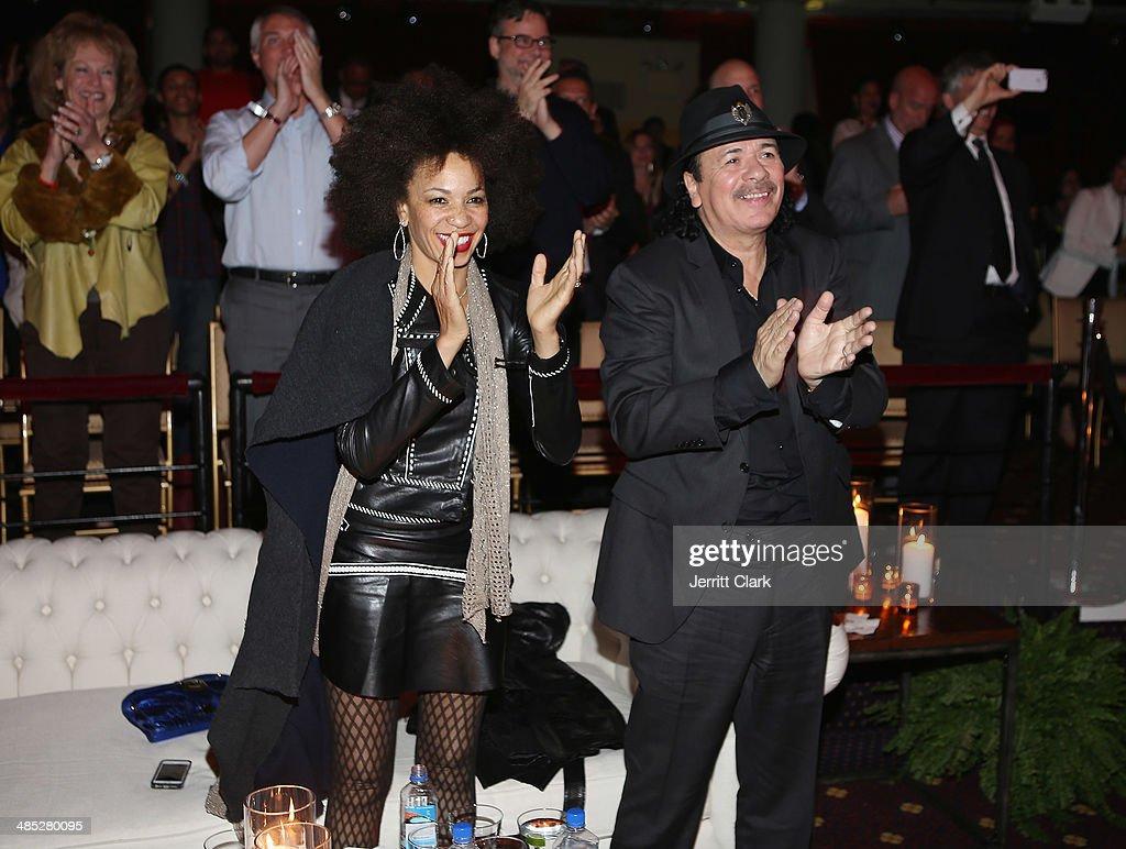 Carlos Santana and wife Cindy Blackman Santana attend the HBO Latino NYC Premiere of 'Santana: De Corazon' at Hudson Theatre on April 16, 2014 in New York City.