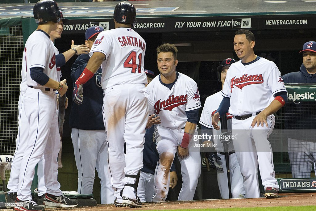 Carlos Santana #41 celebrates with <a gi-track='captionPersonalityLinkClicked' href=/galleries/search?phrase=Nick+Swisher&family=editorial&specificpeople=206417 ng-click='$event.stopPropagation()'>Nick Swisher</a> #33, <a gi-track='captionPersonalityLinkClicked' href=/galleries/search?phrase=Asdrubal+Cabrera&family=editorial&specificpeople=834042 ng-click='$event.stopPropagation()'>Asdrubal Cabrera</a> #13 and other teammates of the Cleveland Indians in the dugout after hitting a solo home run during the sixth inning against the Oakland Athletics at Progressive Field on May 8, 2013 in Cleveland, Ohio.