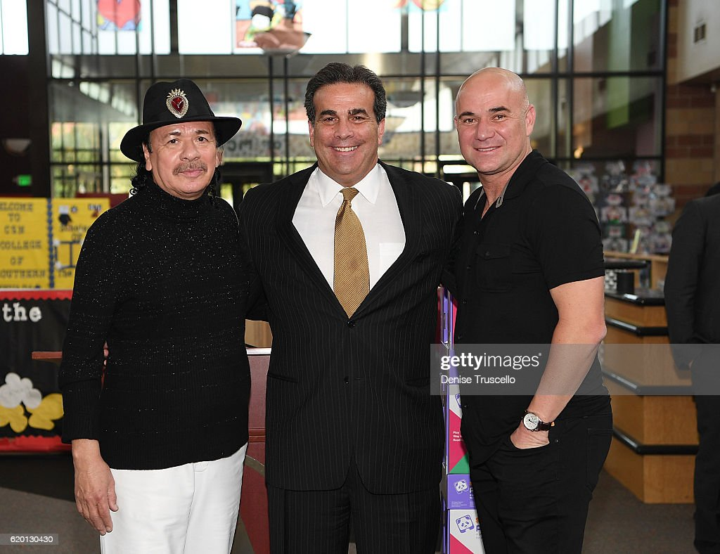 Carlos Santana, CEO, Bank of Nevada John Guedry and Andre Agassi during a press conference to announce a special partnership and research project with Square Panda and the Andre Agassi College Preparatory Academy on November 1, 2016 in Las Vegas, Nevada.