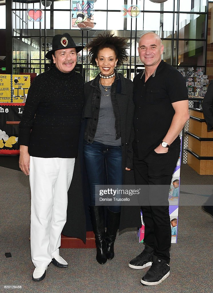 Carlos Santana, Cindy Blackman Santana and Andre Agassi attend a press conference to announce a special partnership and research project with Square Panda and the Andre Agassi College Preparatory Academy on November 1, 2016 in Las Vegas, Nevada.