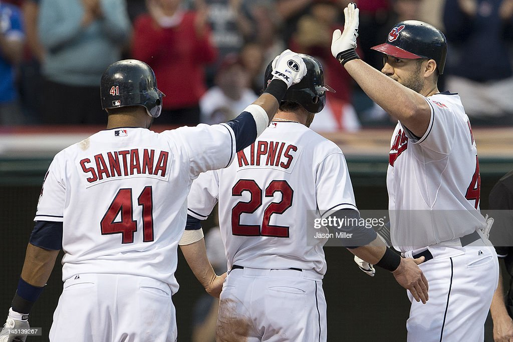 Carlos Santana #41, Jason Kipnis #22 and Travis Hafner #48 of the Cleveland Indians celebrate after Hafner hit a two-run home run during the sixth inning against the Detroit Tigers at Progressive Field on May 23, 2012 in Cleveland, Ohio.
