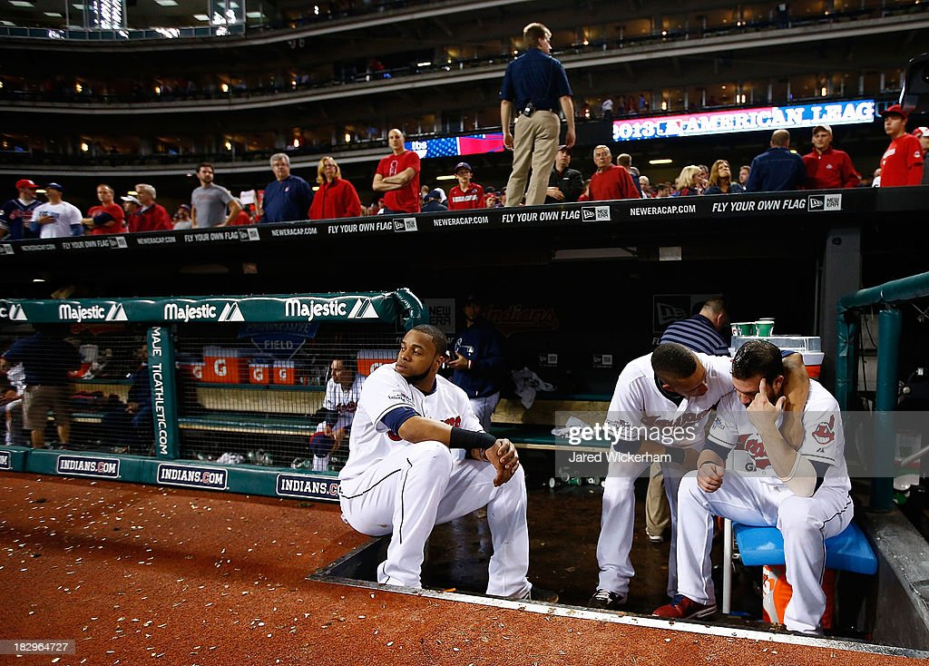 Carlos Santana #41, Michael Brantley #23, and Jason Kipnis #22 of the Cleveland Indians sit in the dugout following their 4-0 loss against the Tampa Bay Rays during the American League Wild Card game at Progressive Field on October 2, 2013 in Cleveland, Ohio.