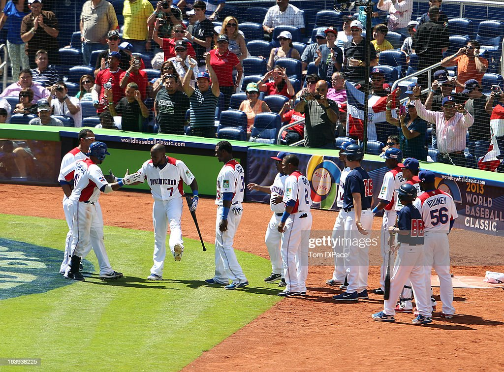 Carlos Santana #41 of Team Dominican Republic celebrates with teammates after hitting a solo home run in the bottom of the fifth inning during Pool 2, Game 6 against Team Puerto Rico in the second round of the 2013 World Baseball Classic on Saturday, March 16, 2013 at Marlins Park in Miami, Florida.