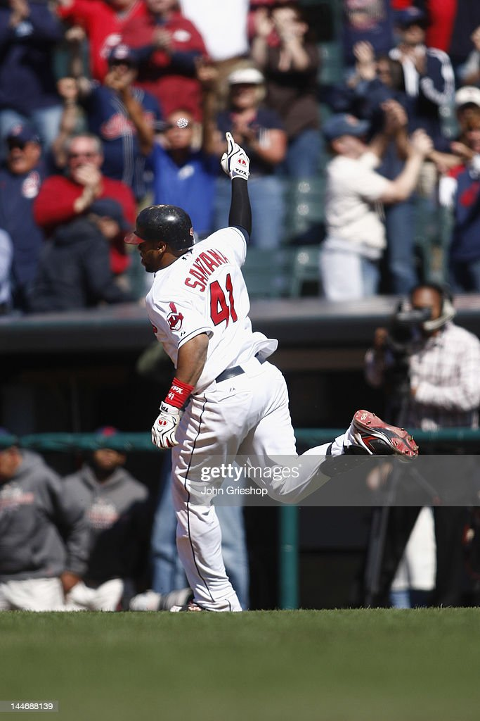 Carlos Santana #41 of the Cleveland Indians celebrates after connecting for a game winning r.b.i. single during the game against the Seattle Mariners at Progressive Field on May 17, 2012 in Cleveland, Ohio. The Indians defeated the Mariners 6-5.
