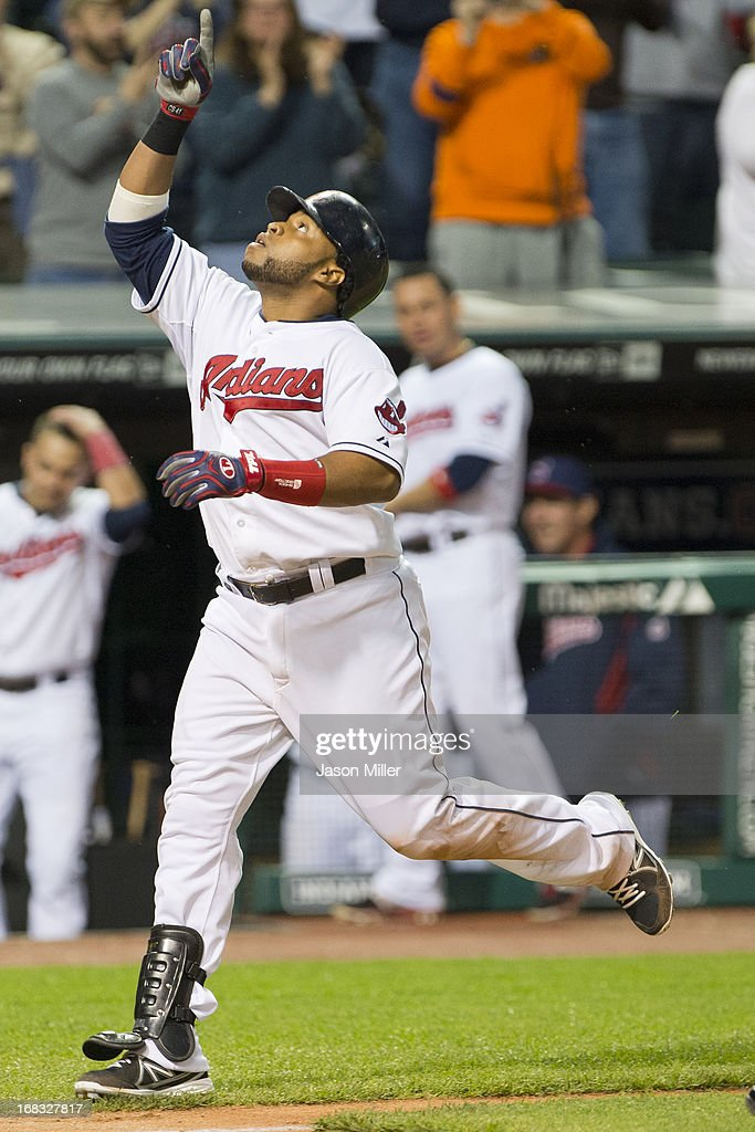 Carlos Santana #41 of the Cleveland Indians celebrates after hiting a solo home run during the sixth inning against the Oakland Athletics at Progressive Field on May 8, 2013 in Cleveland, Ohio.