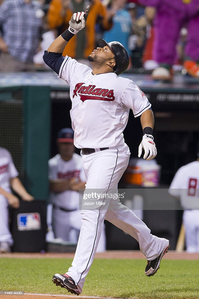 Carlos Santana #41 of the Cleveland Indians celebrates after hitting a solo home run during the seventh inning against the Detroit Tigers at Progressive Field on July 26, 2012 in Cleveland, Ohio.