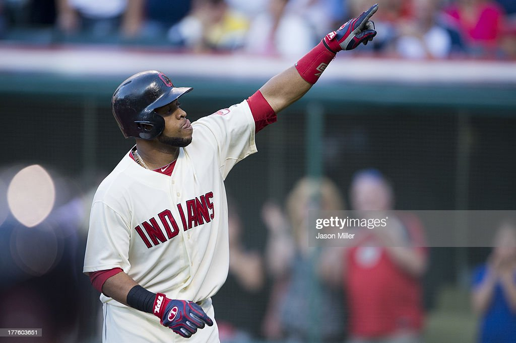 Carlos Santana #41 of the Cleveland Indians celebrates after hitting a two-run home run during the first inning against the Minnesota Twins at Progressive Field on August 24, 2013 in Cleveland, Ohio.