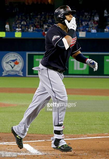 Carlos Santana of the Cleveland Indians celebrates after hitting a solo home run in the third inning against Marco Estrada of the Toronto Blue Jays...