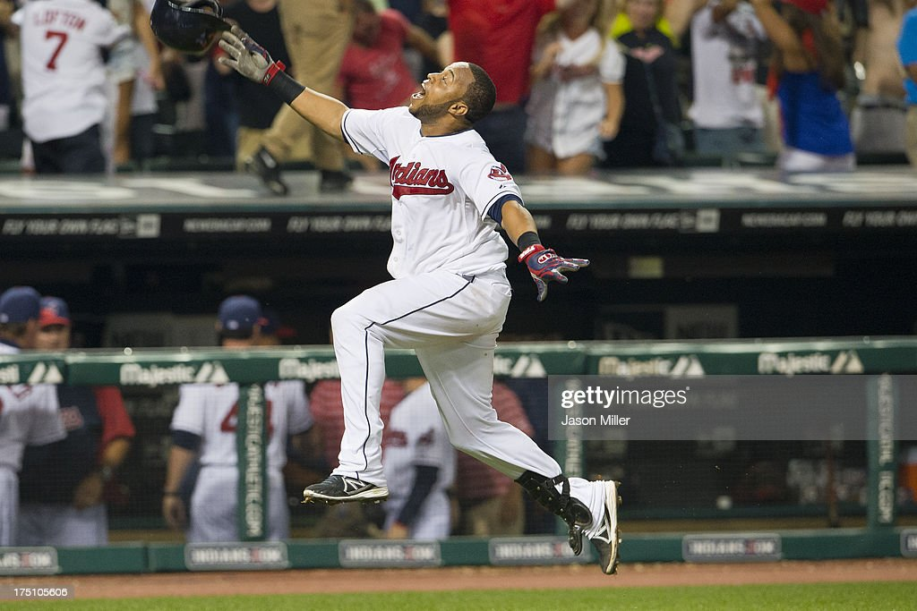 Carlos Santana #41 of the Cleveland Indians celebrates as he runs the third base line after hitting a walk-off solo home run to beat the Chicago White Sox 6-5 in the tenth inning at Progressive Field on July 31, 2013 in Cleveland, Ohio.