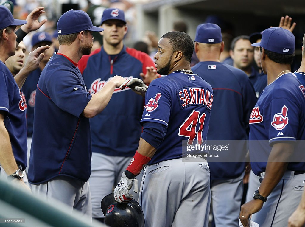 Carlos Santana #23 of the Cleveland Indians celebrates in the dugout after scoring a run in the second inning while playing the Detroit Tigers on August 30, 2013 at Comerca Park in Detroit, Michigan.