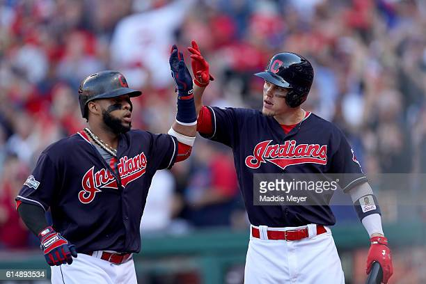 Carlos Santana of the Cleveland Indians celebrates with Brandon Guyer after hitting a home run in the second inning against JA Happ of the Toronto...
