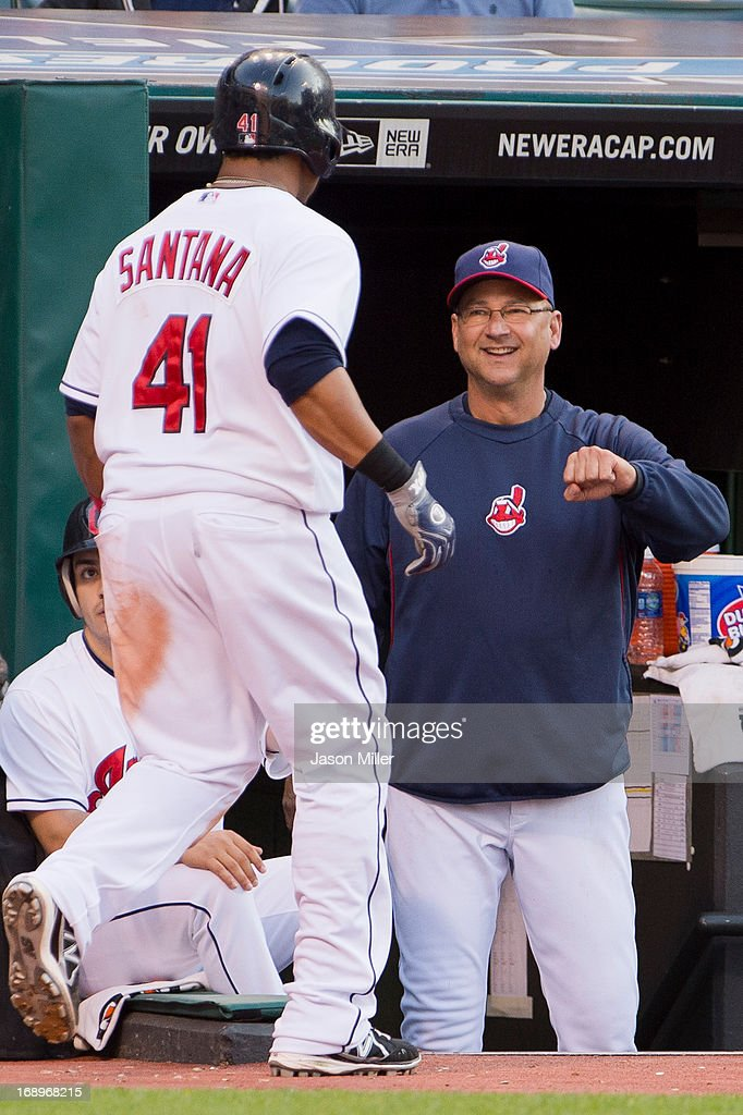 Carlos Santana #41 of the Cleveland Indians celebrates with manager <a gi-track='captionPersonalityLinkClicked' href=/galleries/search?phrase=Terry+Francona&family=editorial&specificpeople=171936 ng-click='$event.stopPropagation()'>Terry Francona</a> #17 after Santana scored on a passed ball during the second inning against the Seattle Mariners at Progressive Field on May 17, 2013 in Cleveland, Ohio.